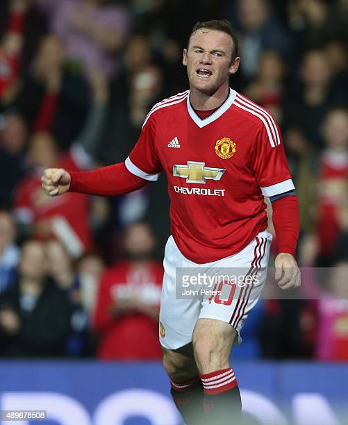 Wayne Rooney of Manchester United celebrates scoring their first goal during the Capital One Cup Third Round match between Manchester United and...