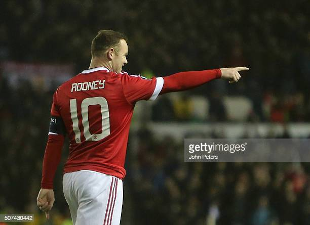 Wayne Rooney of Manchester United celebrates scoring their first goal during the Emirates FA Cup Fourth Round match between Derby County and...