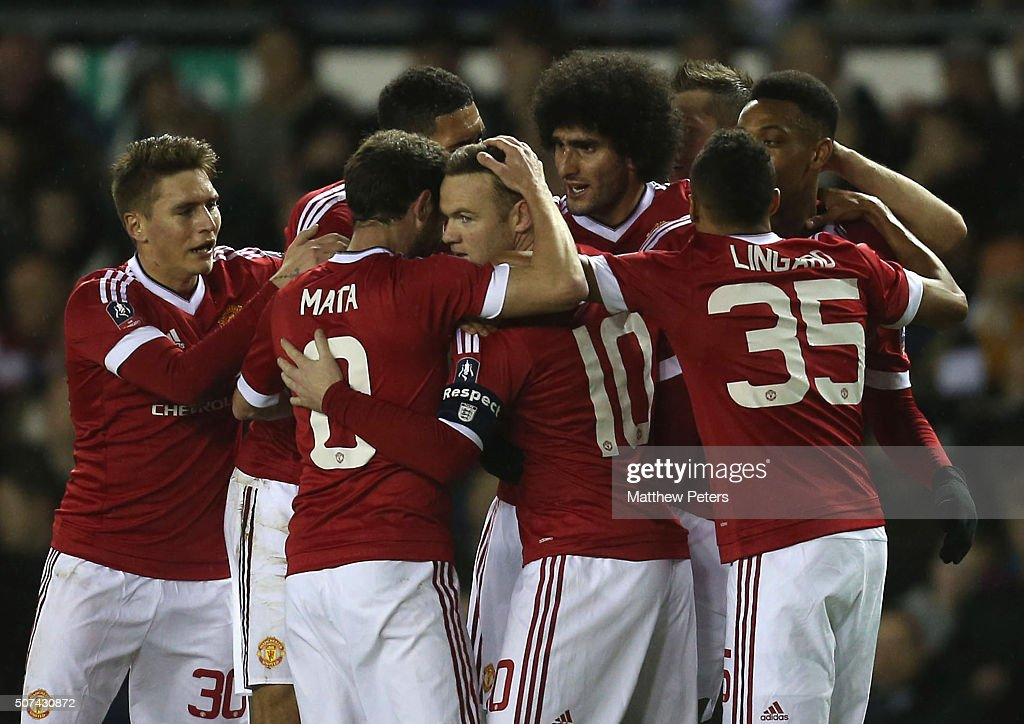 <a gi-track='captionPersonalityLinkClicked' href=/galleries/search?phrase=Wayne+Rooney&family=editorial&specificpeople=157598 ng-click='$event.stopPropagation()'>Wayne Rooney</a> of Manchester United celebrates scoring their first goal during the Emirates FA Cup Fourth Round match between Derby County and Manchester United at Pride Park Stadium on January 29, 2016 in Derby, England.