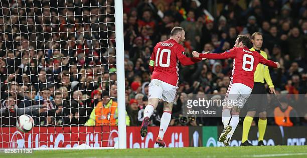 Wayne Rooney of Manchester United celebrates scoring their first goal during the UEFA Europa League match between Manchester United FC and Feyenoord...