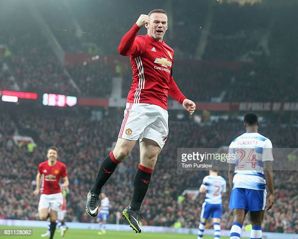 Wayne Rooney of Manchester United celebrates scoring their first goal and equalling Sir Bobby Charlton's club goals record of 249 during the Emirates...