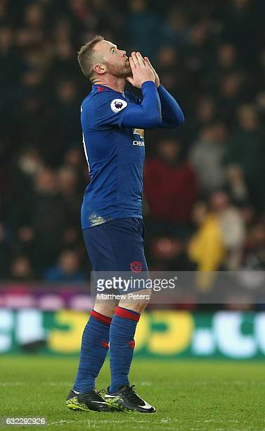 Wayne Rooney of Manchester United celebrates scoring their first goal and becoming the club's record goalscorer with 250 goals during the Premier...
