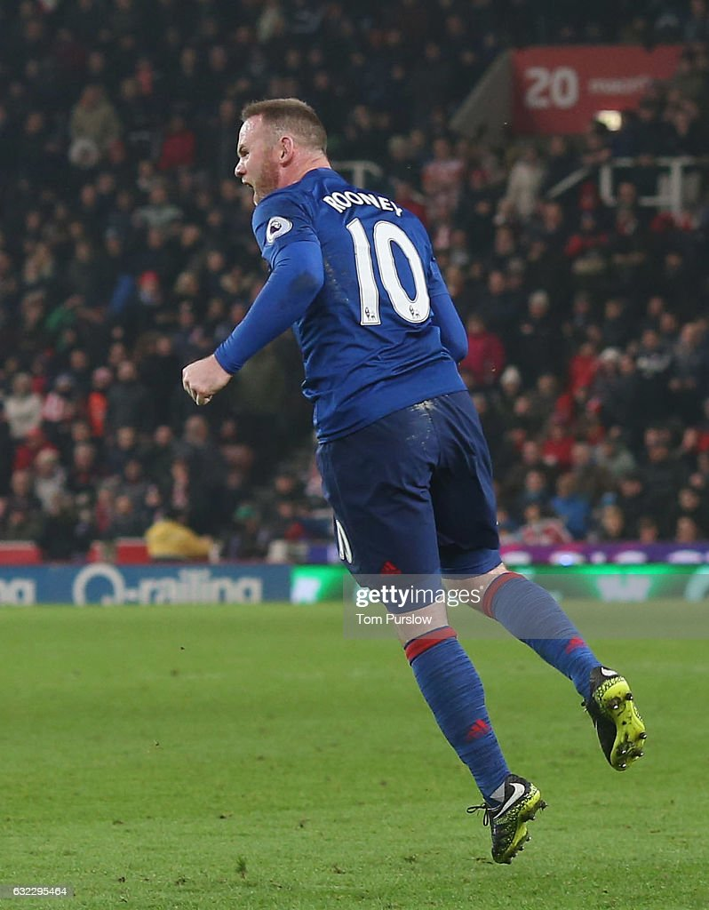 Wayne Rooney of Manchester United celebrates scoring their first goal and becoming the club's record goalscorer with 250 goals during the Premier League match between Stoke City and Manchester United at Bet365 Stadium on January 21, 2017 in Stoke on Trent, England.