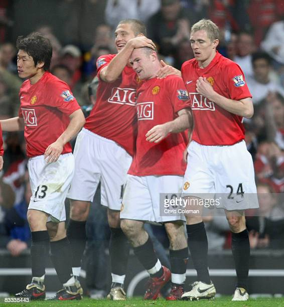 Wayne Rooney of Manchester United celebrates scoring their first goal during the Barclays Premier League match between Manchester United and West...