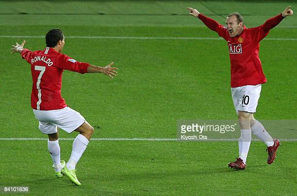 Wayne Rooney of Manchester United celebrates scoring their first goal with teammate Cristiano Ronaldo during the FIFA Club World Cup Japan 2008 final...