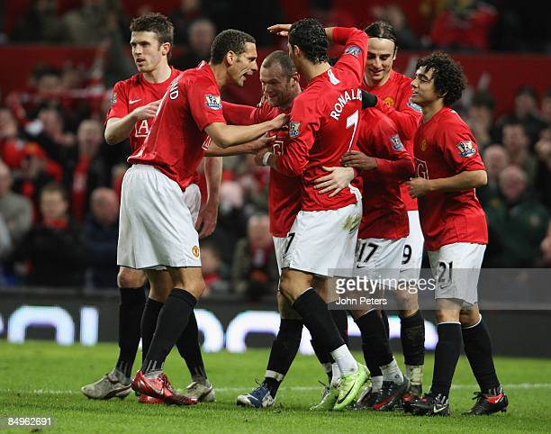 Wayne Rooney of Manchester United celebrates scoring their first goal during the Barclays Premier League match between Manchester United and...