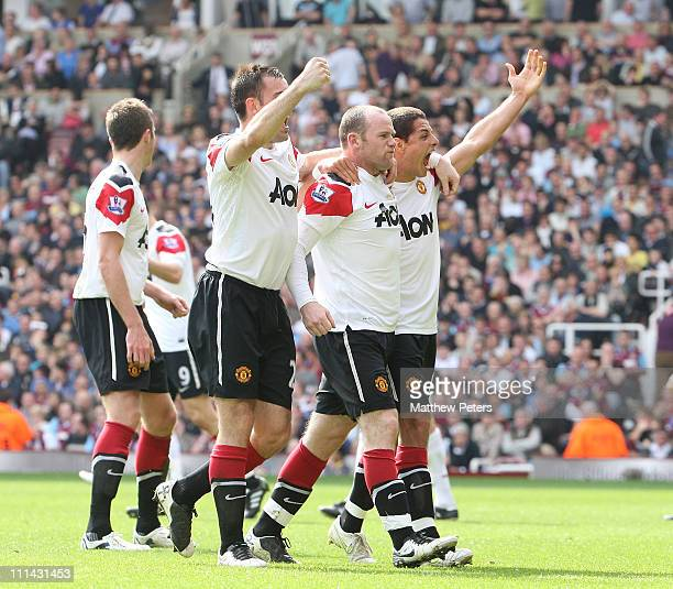 Wayne Rooney of Manchester United celebrates scoring their second goal during the Barclays Premier League match between West Ham United and...