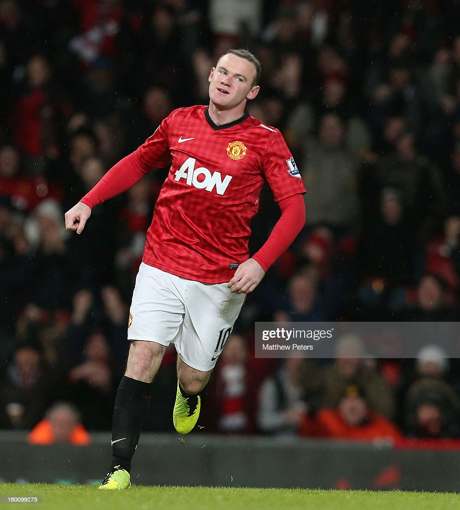 <a gi-track='captionPersonalityLinkClicked' href=/galleries/search?phrase=Wayne+Rooney&family=editorial&specificpeople=157598 ng-click='$event.stopPropagation()'>Wayne Rooney</a> of Manchester United celebrates scoring their second goal during the FA Cup Fourth Round match between Manchester United and Fulham at Old Trafford on January 26, 2013 in Manchester, England.