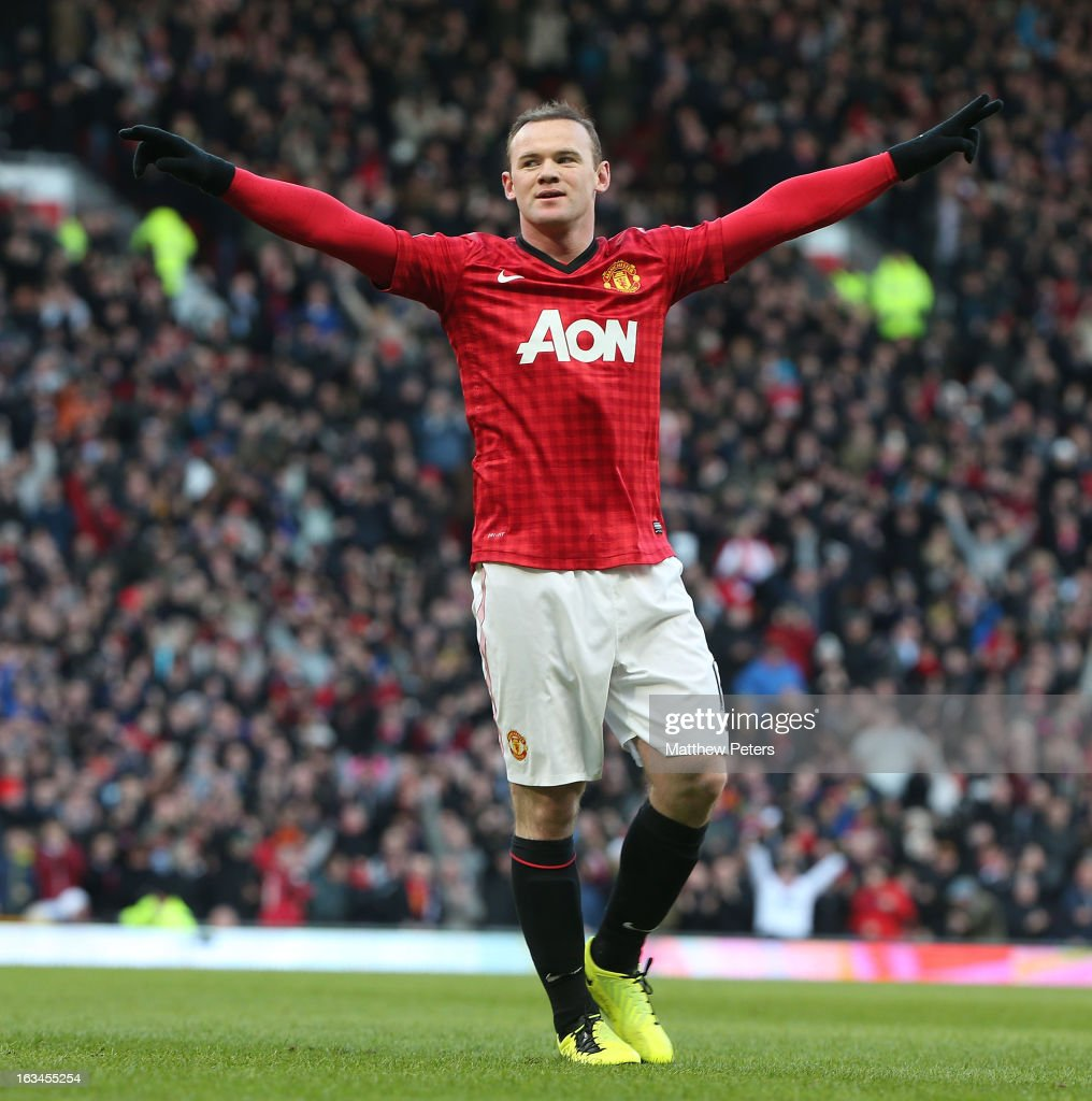 Wayne Rooney of Manchester United celebrates scoring their second goal during the FA Cup Sixth Round match between Manchester United and Chelsea at Old Trafford on March 10, 2013 in Manchester, England.