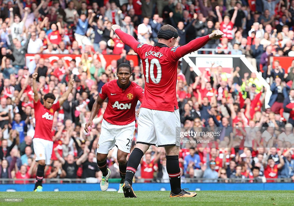 Wayne Rooney of Manchester United celebrates scoring their second goal during the Barclays Premier League match between Manchester United and Crystal Palace at Old Trafford on September 14, 2013 in Manchester, England.
