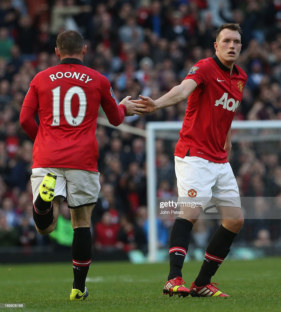 <a gi-track='captionPersonalityLinkClicked' href=/galleries/search?phrase=Wayne+Rooney&family=editorial&specificpeople=157598 ng-click='$event.stopPropagation()'>Wayne Rooney</a> of Manchester United celebrates scoring their second goal during the Barclays Premier League match between Manchester United and Stoke City at Old Trafford on October 26, 2013 in Manchester, England.