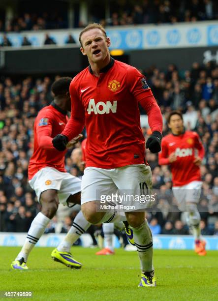 Wayne Rooney of Manchester United celebrates scoring their second goal from the penalty spot during the Barclays Premier League Match between...
