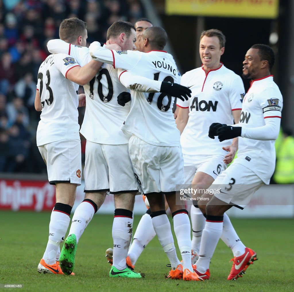 <a gi-track='captionPersonalityLinkClicked' href=/galleries/search?phrase=Wayne+Rooney&family=editorial&specificpeople=157598 ng-click='$event.stopPropagation()'>Wayne Rooney</a> of Manchester United celebrates scoring their second goal during the Barclays Premier League match between Hull City and Manchester United at KC Stadium on December 26, 2013 in Hull, England.