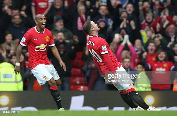 Wayne Rooney of Manchester United celebrates scoring their third goal during the Barclays Premier League match between Manchester United and...