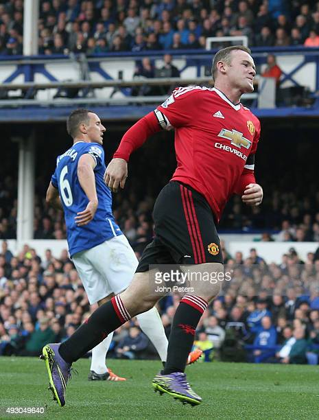 Wayne Rooney of Manchester United celebrates scoring their third goal during the Barclays Premier League match between Everton and Manchester United...