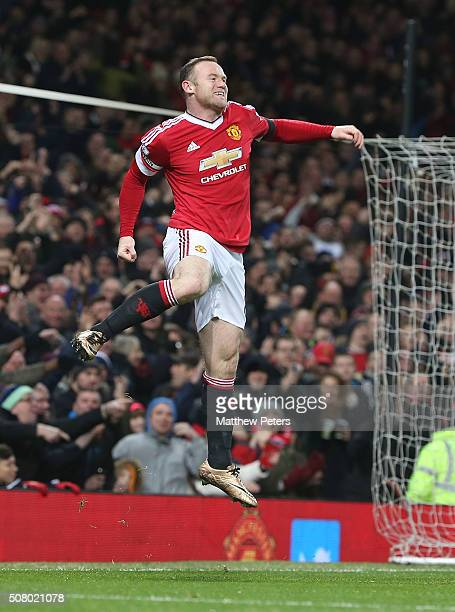 Wayne Rooney of Manchester United celebrates scoring their third goal during the Barclays Premier League match between Manchester United and Stoke...