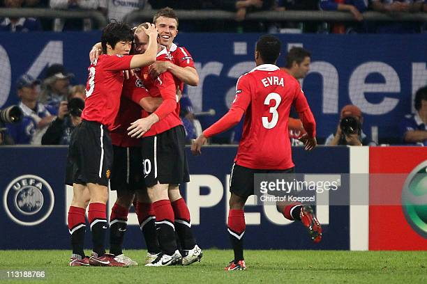 Wayne Rooney of Manchester United celebrates the second goal with JiSung Park and Michael Carrick of Manchester United and Patrice Evra of Manchester...