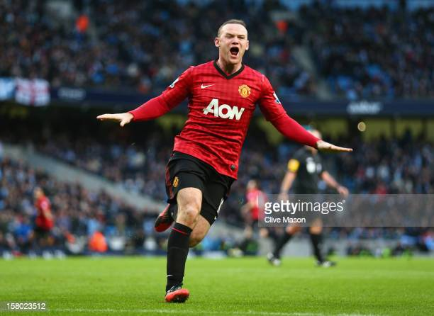 Wayne Rooney of Manchester United celebrates the winning goal during the Barclays Premier League match between Manchester City and Manchester United...