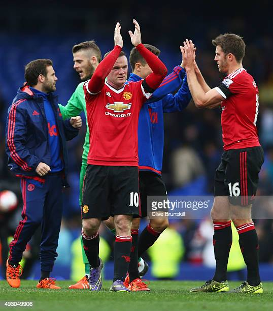 Wayne Rooney of Manchester United celebrates their 30 win in the Barclays Premier League match between Everton and Manchester United at Goodison Park...
