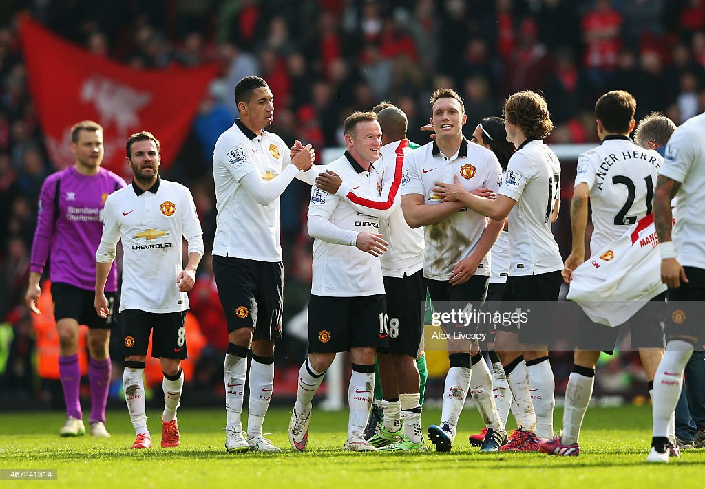 Wayne Rooney of Manchester United celebrates victory with team mates after the Barclays Premier League match between Liverpool and Manchester United at Anfield on March 22, 2015 in Liverpool, England.