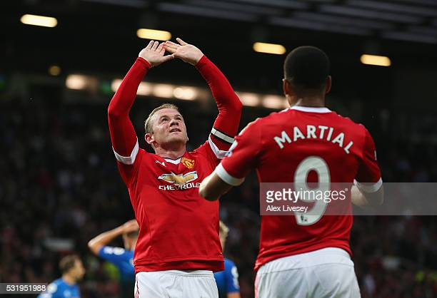 Wayne Rooney of Manchester United celebrates with Anthony Martial as he scores their first goal during the Barclays Premier League match between...
