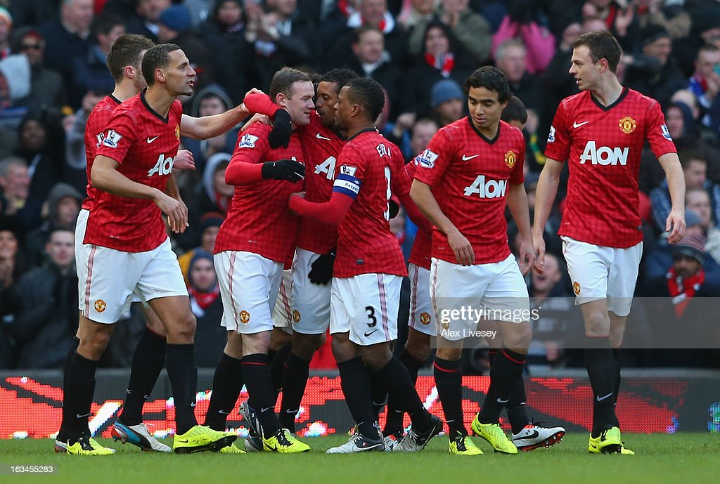 Wayne Rooney of Manchester United celebrates with his team-mates after scoring his team's second goal during the FA Cup sponsored by Budweiser Sixth Round match between Manchester United and Chelsea at Old Trafford on March 10, 2013 in Manchester, England.