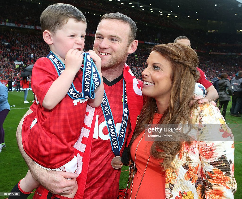 <a gi-track='captionPersonalityLinkClicked' href=/galleries/search?phrase=Wayne+Rooney&family=editorial&specificpeople=157598 ng-click='$event.stopPropagation()'>Wayne Rooney</a> of Manchester United celebrates with his wife Coleen and son Kai after the Barclays Premier League match between Manchester United and Swansea City at Old Trafford on May 12, 2013 in Manchester, England.