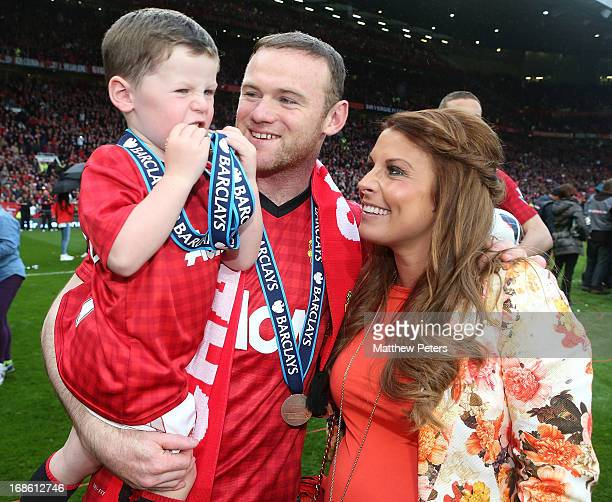 Wayne Rooney of Manchester United celebrates with his wife Coleen and son Kai after the Barclays Premier League match between Manchester United and...