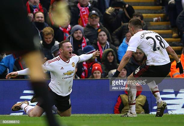 Wayne Rooney of Manchester United celebrates with Morgan Schneiderlin after scoring the winning goal during the Barclays Premier League match between...