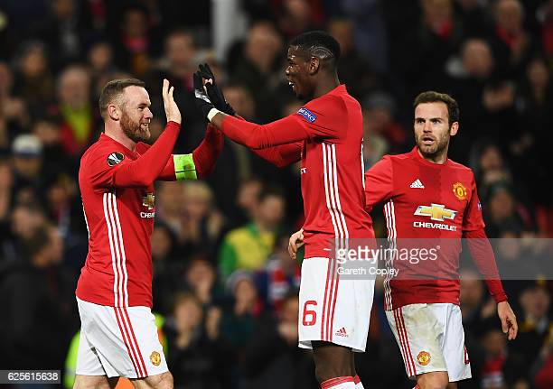 Wayne Rooney of Manchester United celebrates with Paul Pogba as he scores their first goal during the UEFA Europa League Group A match between...