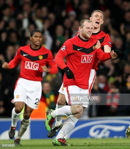 Wayne Rooney of Manchester United celebrates with team mate Darren Fletcher after scoring his team's second goal during the UEFA Champions League...