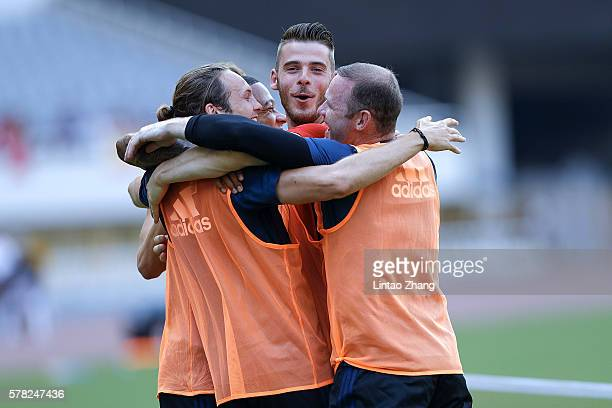 Wayne Rooney of Manchester United celebrates with team mate during the team training session as part of their preseason tour of China at Shanghai...