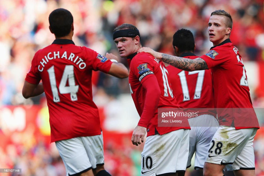 <a gi-track='captionPersonalityLinkClicked' href=/galleries/search?phrase=Wayne+Rooney&family=editorial&specificpeople=157598 ng-click='$event.stopPropagation()'>Wayne Rooney</a> (C) of Manchester United celebrates with team mates after scoring the Barclays Premier League match between Manchester United and West Bromwich Albion at Old Trafford on September 28, 2013 in Manchester, England.