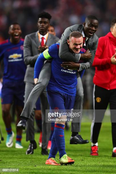 Wayne Rooney of Manchester United celebrates with teammate Eric Bailly following the UEFA Europa League Final match between Ajax and Manchester...