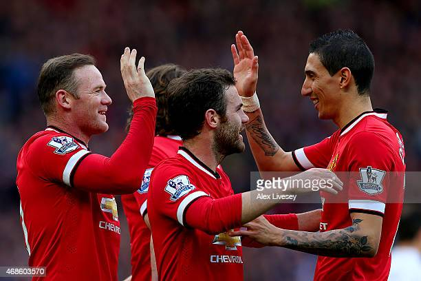Wayne Rooney of Manchester United celebrates with teammates after scoring his team's second goal during the Barclays Premier League match between...