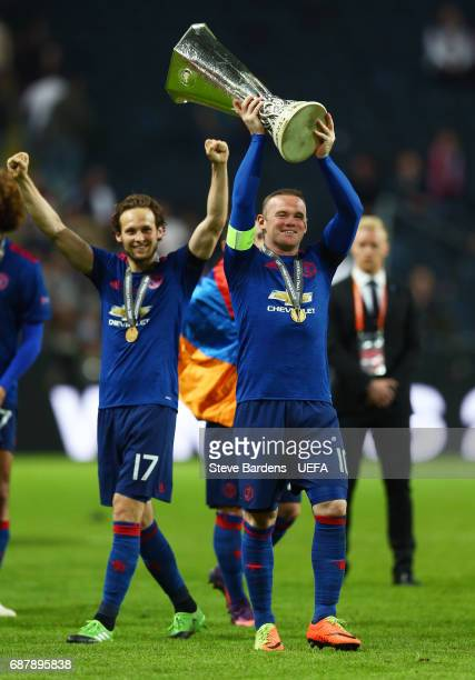 Wayne Rooney of Manchester United celebrates with The Europa League trophy after the UEFA Europa League Final between Ajax and Manchester United at...
