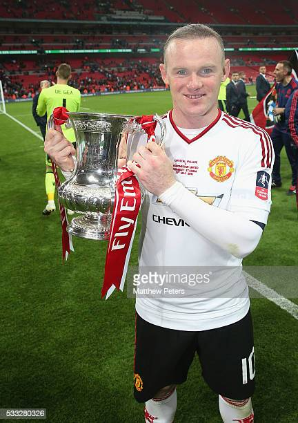 Wayne Rooney of Manchester United celebrates with the FA Cup trophy after The Emirates FA Cup final match between Manchester United and Crystal...