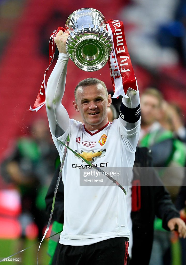<a gi-track='captionPersonalityLinkClicked' href=/galleries/search?phrase=Wayne+Rooney&family=editorial&specificpeople=157598 ng-click='$event.stopPropagation()'>Wayne Rooney</a> of Manchester United celebrates with the trophy after winning The Emirates FA Cup Final match between Manchester United and Crystal Palace at Wembley Stadium on May 21, 2016 in London, England.