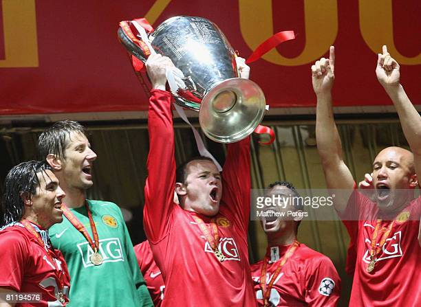 Wayne Rooney of Manchester United celebrates with the trophy after winning the UEFA Champions League Final match between Manchester United and...