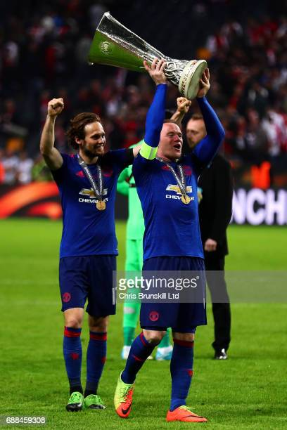 Wayne Rooney of Manchester United celebrates with the trophy following the UEFA Europa League Final match between Ajax and Manchester United at...