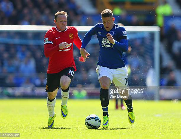 Wayne Rooney of Manchester United chases Ross Barkley of Everton during the Barclays Premier League match between Everton and Manchester United at...