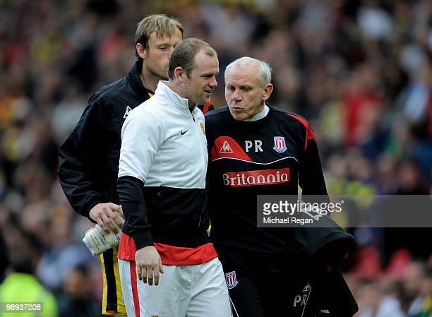 Wayne Rooney of Manchester United chats with Peter Reid at the end of the Barclays Premier League match between Manchester United and Stoke City at...