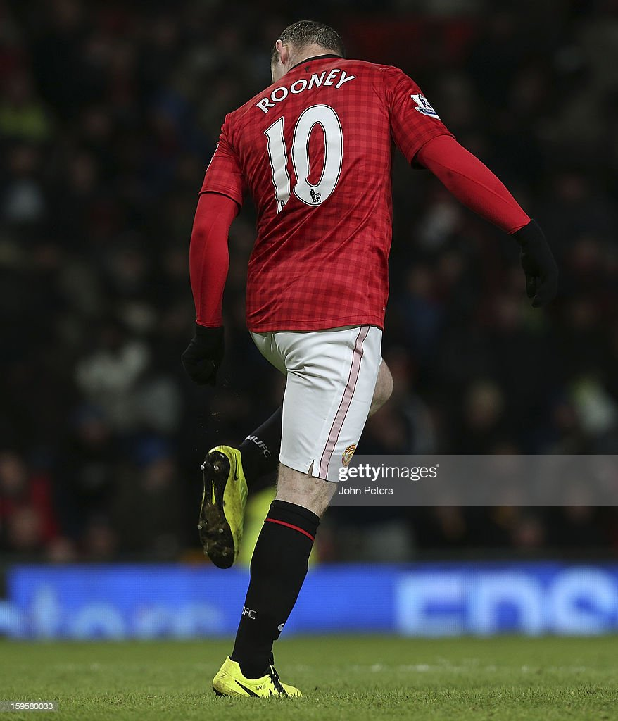 <a gi-track='captionPersonalityLinkClicked' href=/galleries/search?phrase=Wayne+Rooney&family=editorial&specificpeople=157598 ng-click='$event.stopPropagation()'>Wayne Rooney</a> of Manchester United checks his boots after missing a penalty during the FA Cup Third Round Replay match between Manchester United and West Ham United at Old Trafford on January 16, 2013 in Manchester, England.