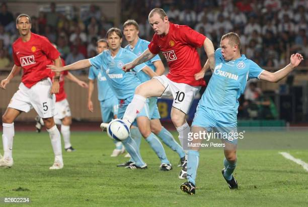 Wayne Rooney of Manchester United clashes with Aleksandr Anyukov of Zenit St Petersburg during the UEFA Supercup match between Manchester United and...