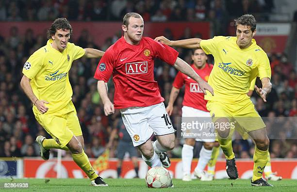 Wayne Rooney of Manchester United clashes with Edmilson of Villarreal during the UEFA Champions League match between Manchester United and Villarreal...