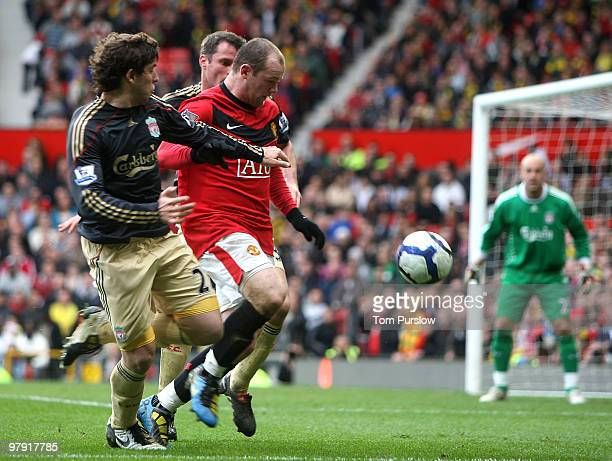 Wayne Rooney of Manchester United clashes with Emiliano Insua of Liverpool the FA Barclays Premier League match between Manchester United and...