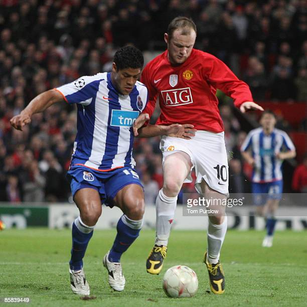 Wayne Rooney of Manchester United clashes with Hulk of FC Porto during the UEFA Champions League QuarterFinal First Leg match between Manchester...