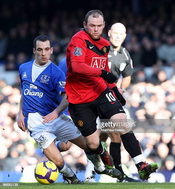 Wayne Rooney of Manchester United clashes with Leon Osman of Everton during the FA Barclays Premier League match between Everton and Manchester...
