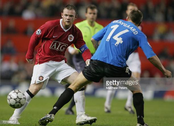 Wayne Rooney of Manchester United clashes with Michael Gravgaard of FC Copenhagen during the UEFA Champions League match between Manchester United...