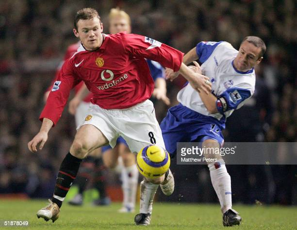 Wayne Rooney of Manchester United clashes with Michael Hughes of Crystal Palace during the Barclays Premiership match between Manchester United and...